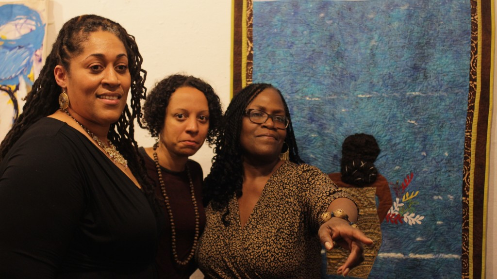 Keisha-Gaye Anderson with poets Charan P. Morris and Jacqueline Johnson at The Artivist Rises exhibition hosted by African Voices.